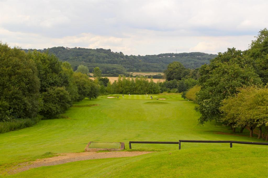 This picturesque par 3 looks out over the Surrey hills but dont let that take your mind away from your game, as this is a very long and difficult hole that requires a solidly struck long iron or wood but accuracy is vital if you are to find the putting surface. Too long however is where the trouble lies with out of bounds lurking!